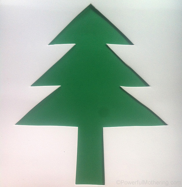 cutting the shape  of the christmas tree out