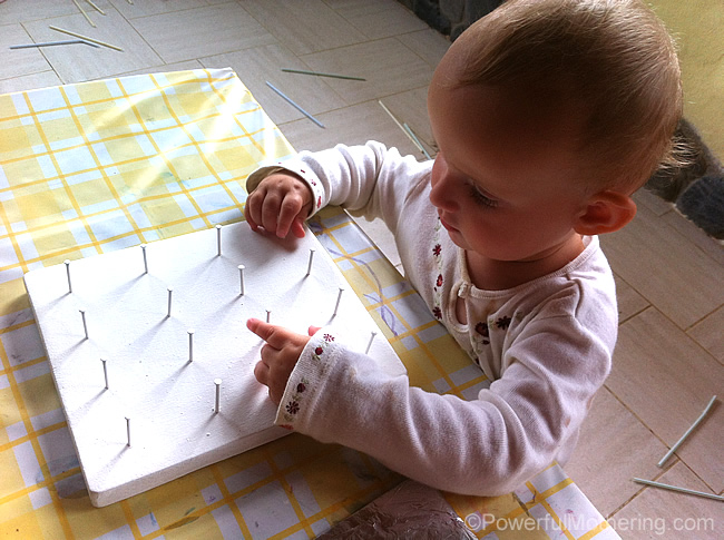 toddler wanting to use geoboard