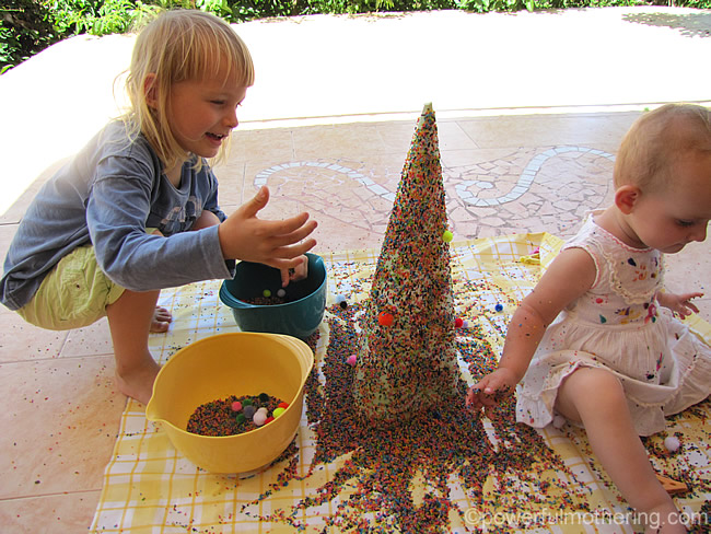 sprinkle or throw color rice at the tree