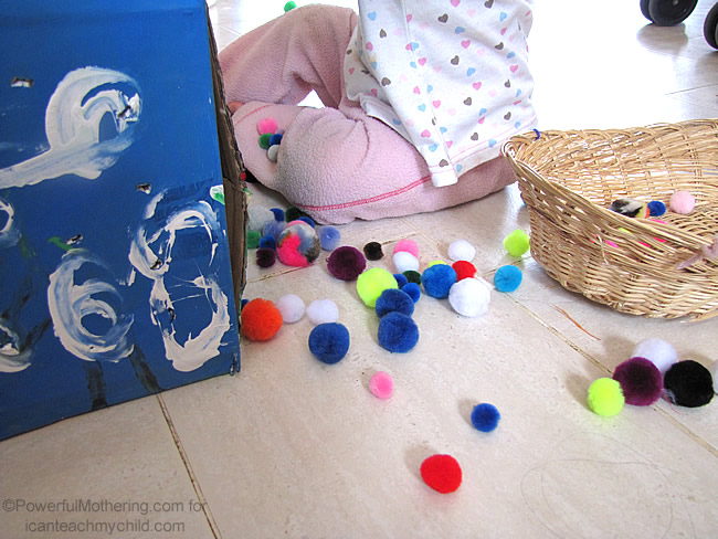 busy toddlers in the kitchen Pom Pom Drop  Keeping Toddlers Busy