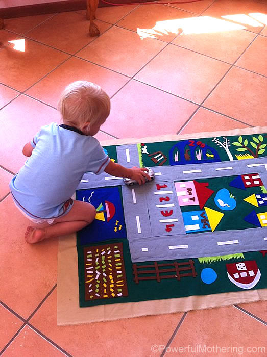 playing oon the felt play mat