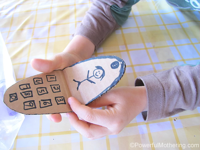 pretend play with cardboard phone