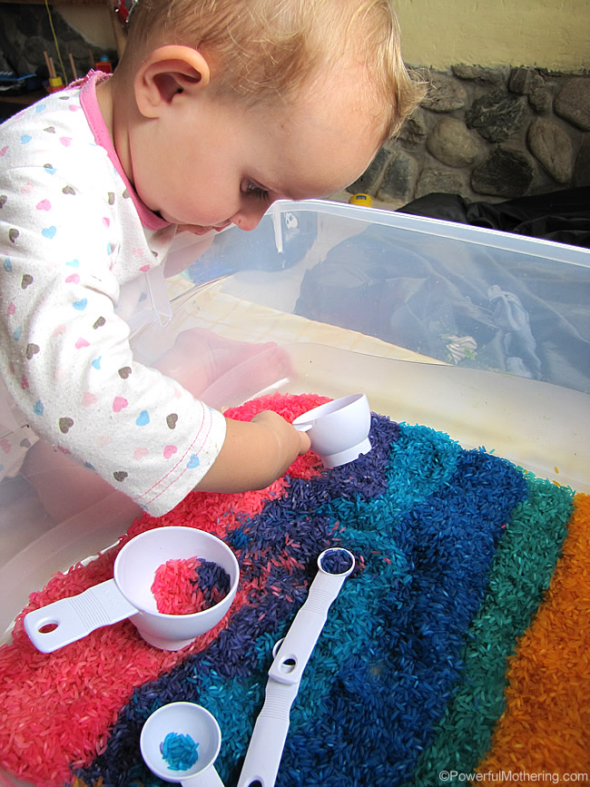 sensory tub exploring with dyed color rice