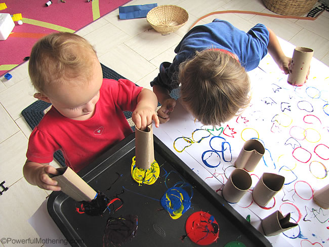 toddlers enjoying stamping