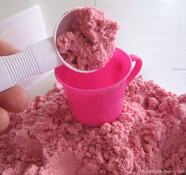 Scooping pretty sensory dough pink