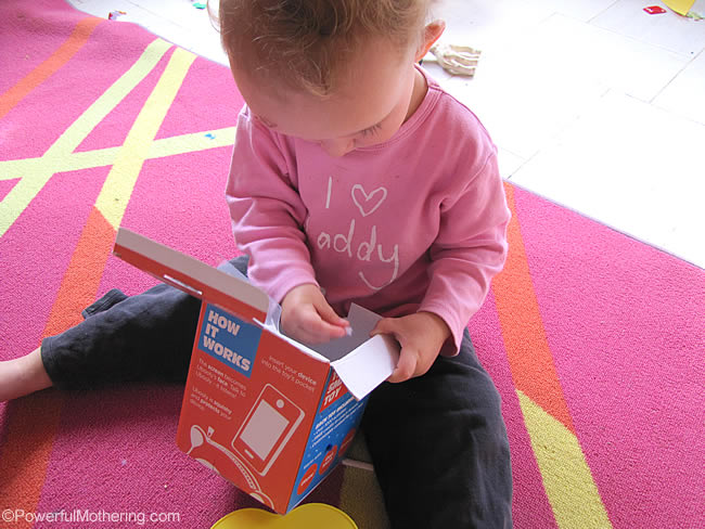 use an empty box for fine motor skills