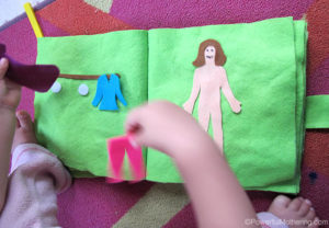 felt Doll Dressing No Sew Quiet Book Page in action