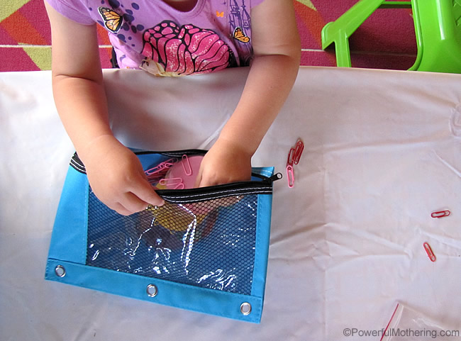 packing paperclips away into a bsy bag