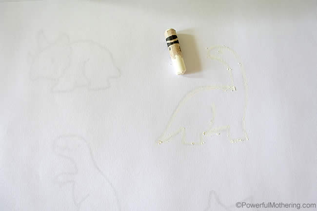 tracing dinosaurs with white was crayon
