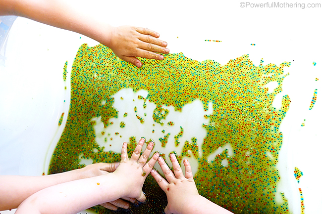 hands in the sensory bin