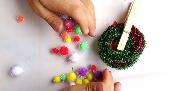fine motor skills with pom poms pegs and pipe cleaners