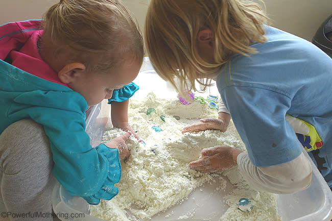 sensory bin with snow dough