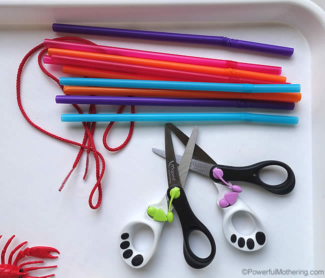 set up for cutting and threading straws for fine motor skills