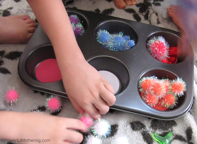 fine motor muffin tin practice with pom poms