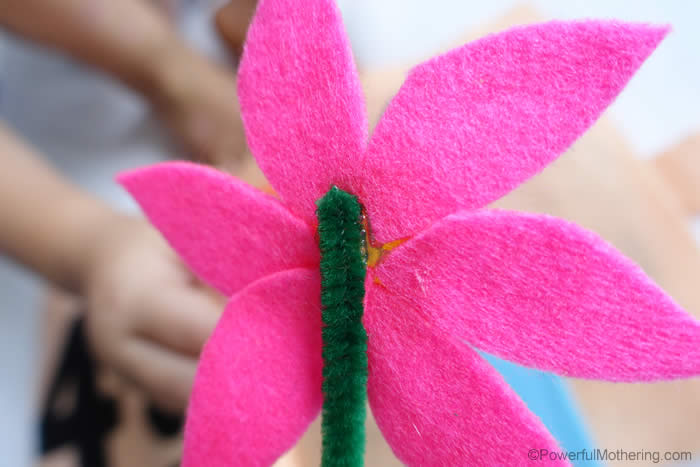 attach pipecleaner to back of flower