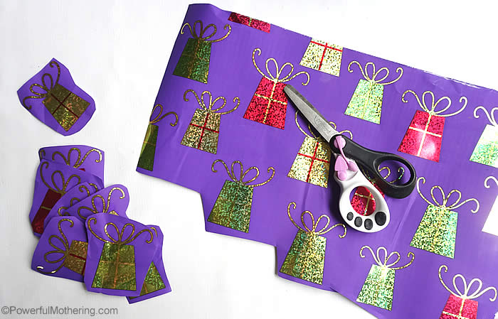 cutting out gift wrap shapes