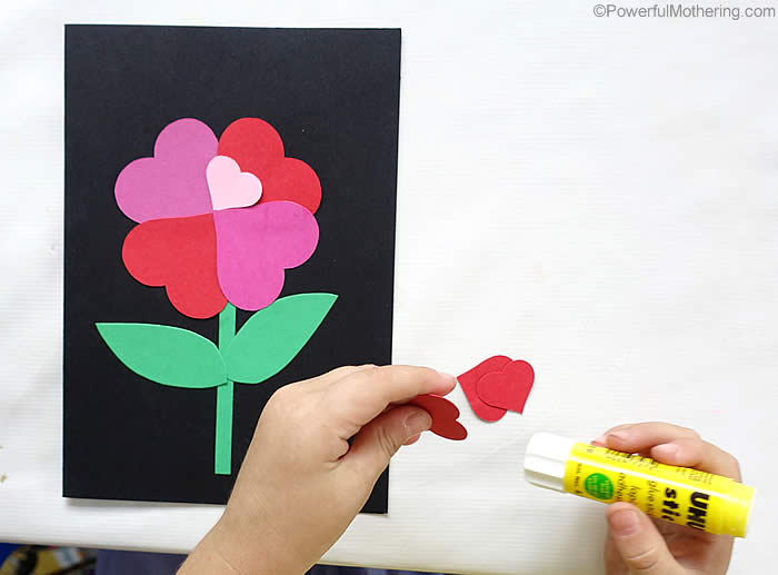 pasting hearts on a card