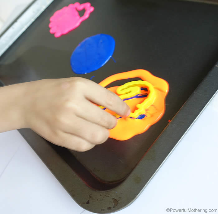 using playdough stamps with paint