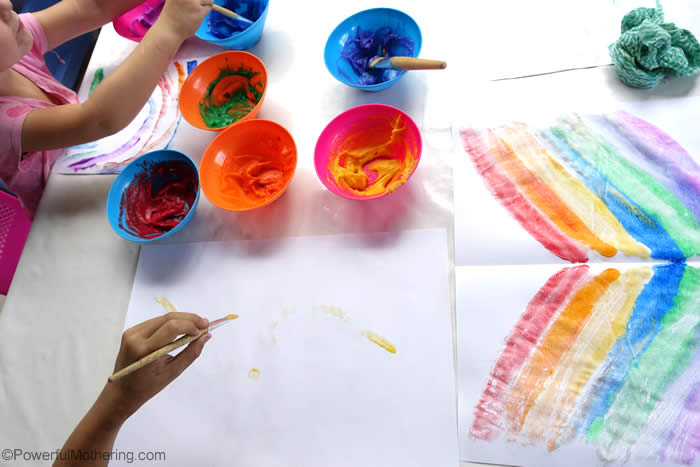 art exploration with rainbow paint