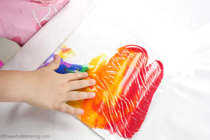 fine motor skills with squishing paint