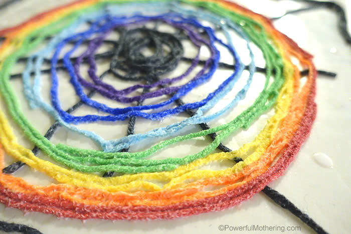 drying yarn rainbow spider web