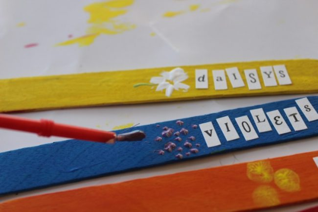 Planting a rainbow garden markers craft