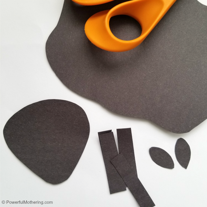 Cutting Paper For A Sheep Craft