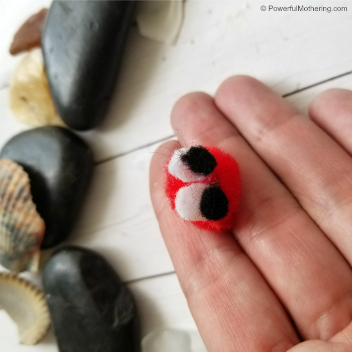 Adding eyes to pompom hermit crab craft