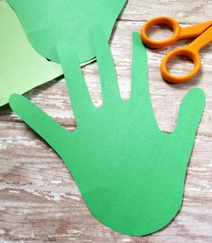 Cutting Out Hand Prints For A Family Tree Craft For Kids