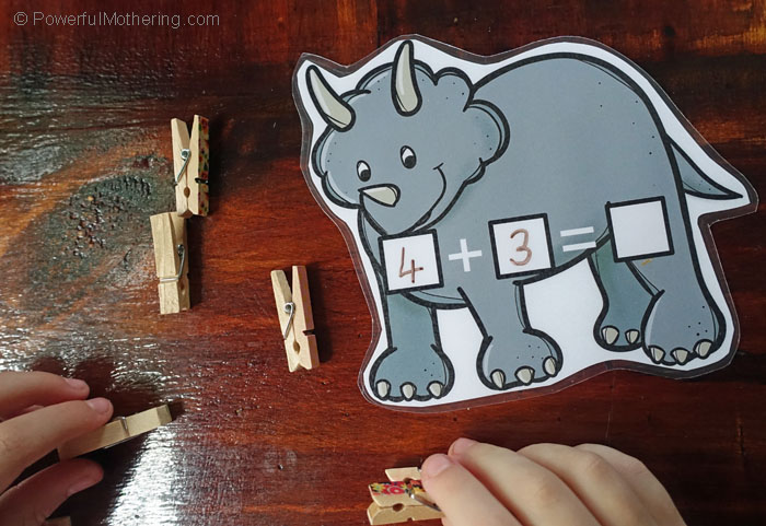 A Free Dinosaur Math Printable In A Busy Bag to help children practice both addition and subtraction in an easy and fun way.