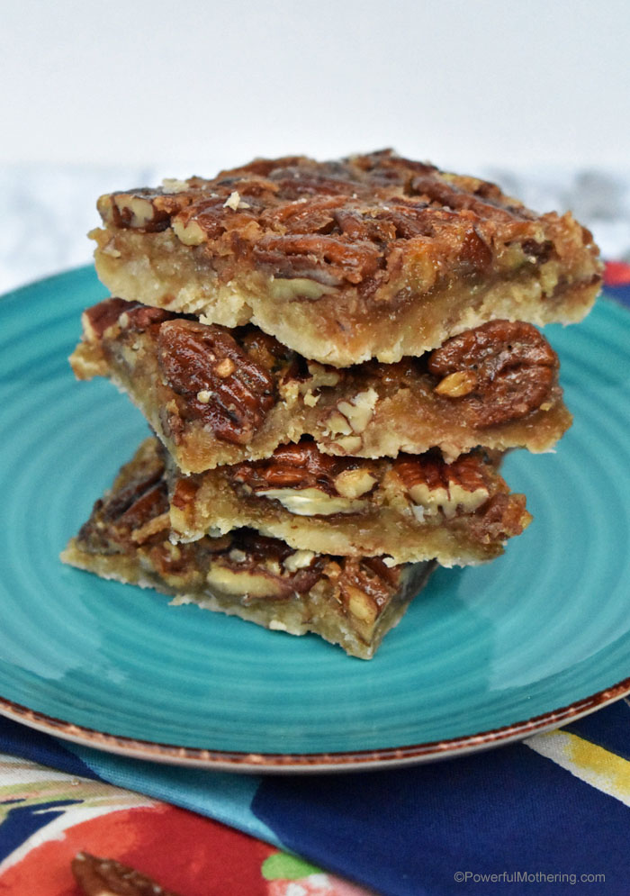 Think Thanksgiving Pecan Pie but in bar form. This recipe is filled with Grandma's love with a modern twist. These Pecan Pie Bars will not disappoint.